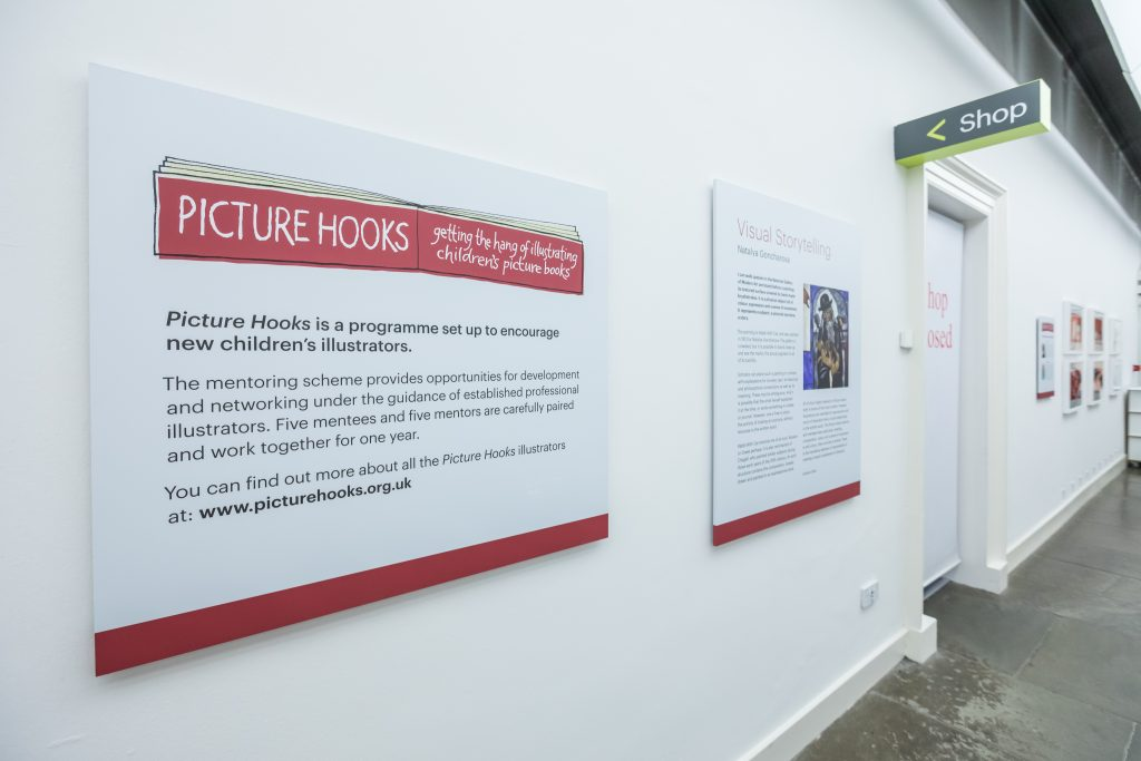 The information panel for the Picture Hooks exhibition featuring a red and white logo.